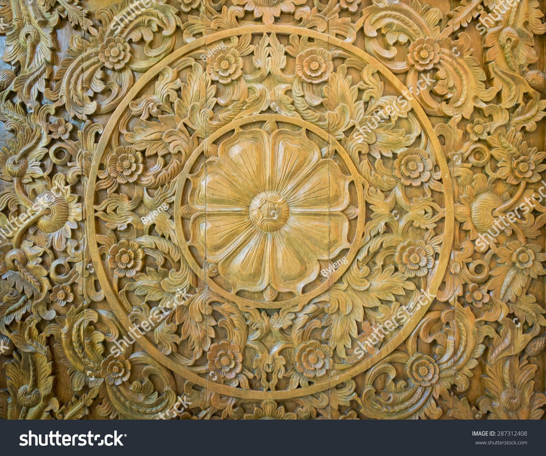 的花朵雕刻在木头背景模式-背景/素材-海洛创意()-合